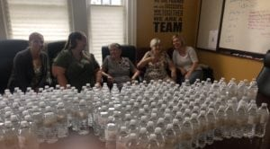 Our Team taking a break from prepping water bottles for the Alzheimer's Walk