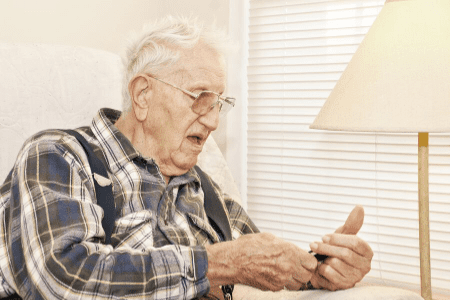 Elderly Man with cell Phone- Help prevent your senior from falling for a phone scam